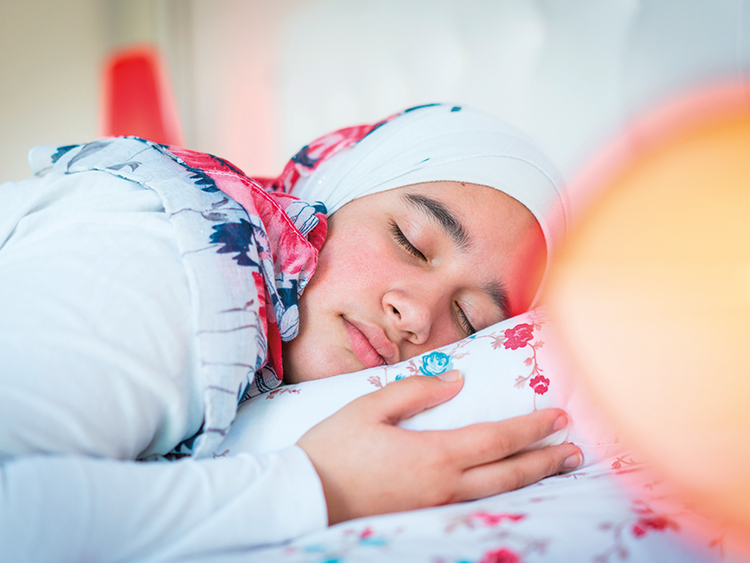 Muslim woman in hijab sleeping in on Eid - eid personality