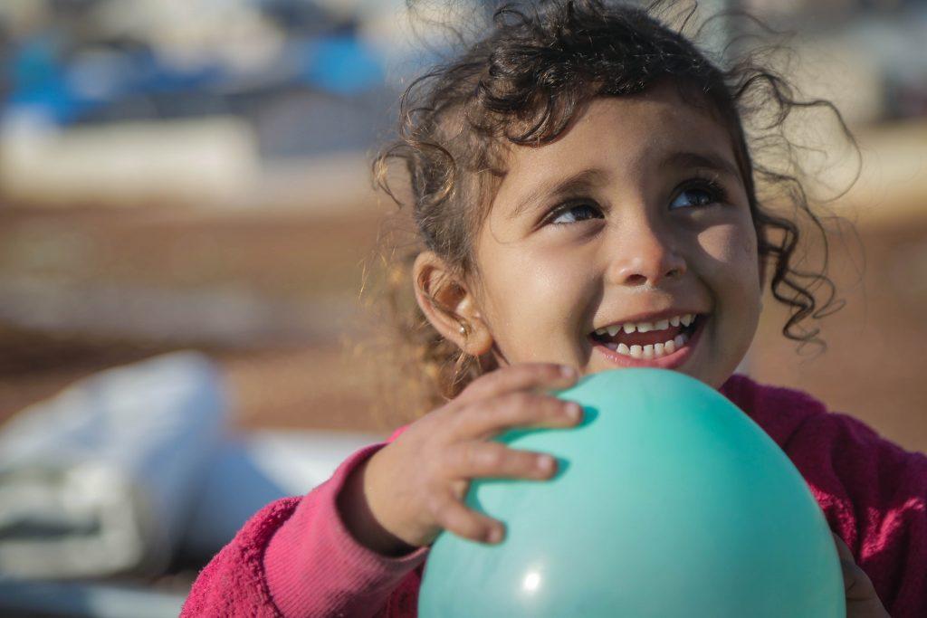 Orphan girl with balloon